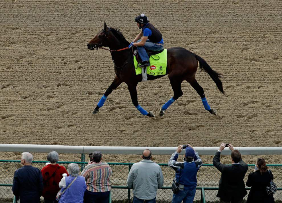 Exercise rider Mario Garcia rides Kentucky Derby hopeful Mo Tom during a workout at Churchill Downs Wednesday, May 4, 2016, in Louisville, Ky. The 142nd running of the Kentucky Derby is scheduled for Saturday, May 7. (AP Photo/Charlie Riedel)